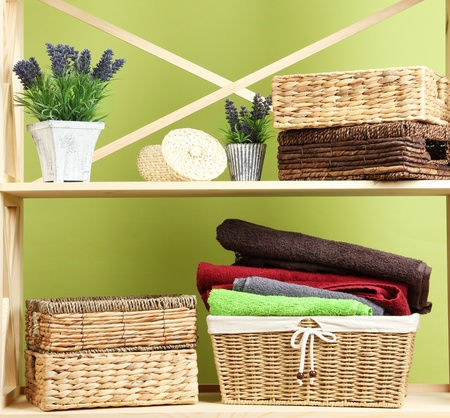 Beautiful white shelves with different home related objects, on color wall background Stock Photo - 21245696
