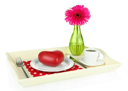 Wooden tray with breakfast,  isolated on white photo