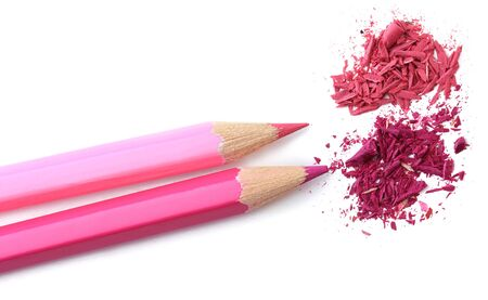 Pink pencils with sharpening shavings isolated on white