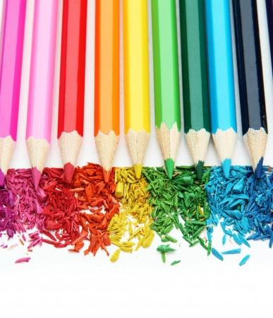 sharpening: Colour pencils with sharpening shavings isolated on white Stock Photo