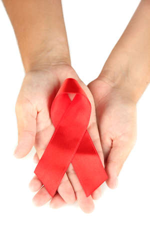 AIDS ribbon in hands isolated on white photo