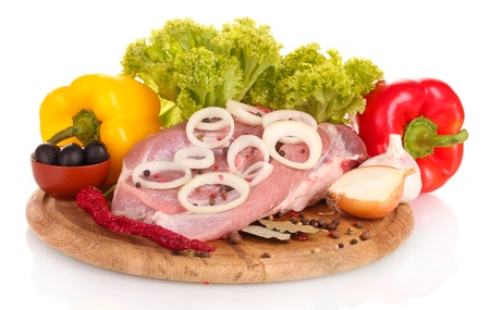 uncooked bacon: Raw meat and vegetables on a wooden board isolated on whitе
