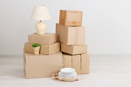 packing boxes: Moving boxes on the floor in empty room