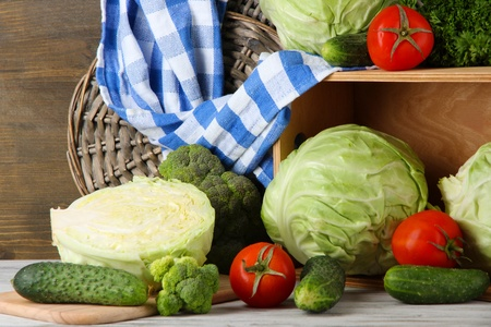 dacha: Composition of vegetables on table on wooden background