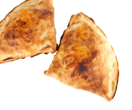 Pizza calzones isolated on white photo