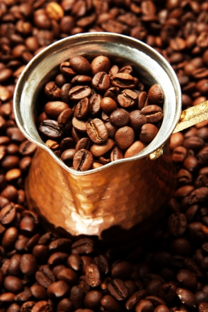 coffee pot: Metal turk on coffee beans background