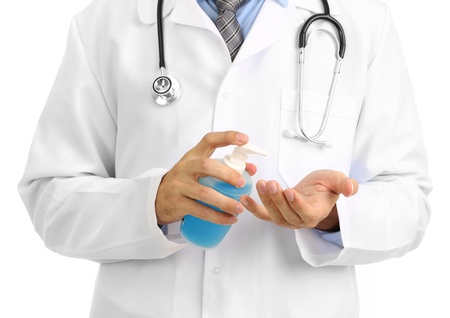 Medical doctor using sanitizer dispenser photo