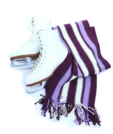 Figure skates with scarf isolated on white Reklamní fotografie