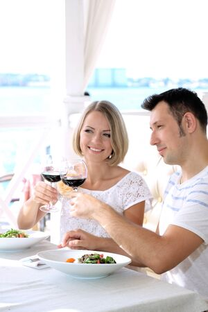 Beautiful couple having  romantic dinner at restaurant Stock Photo - 21514990