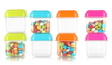 tupperware: Empty and full of plastic containers isolated on white
