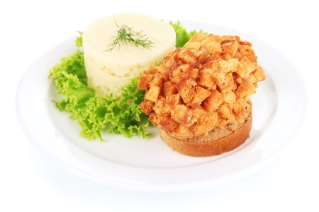 Chicken Kiev on croutons with mashed potatoes, isolated on white photo