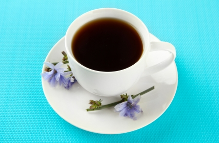 chicory coffee: Cup of tea with chicory, on blue background