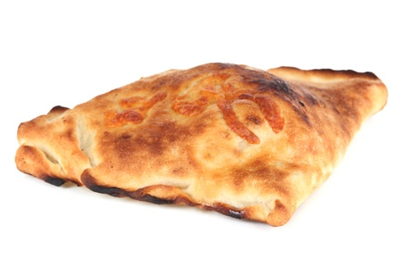 Pizza calzone isolated on white photo