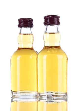 Minibar bottles, isolated on white photo