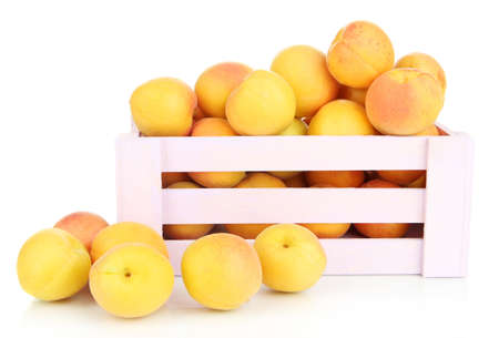 Fresh natural apricot in wooden box isolated on white photo