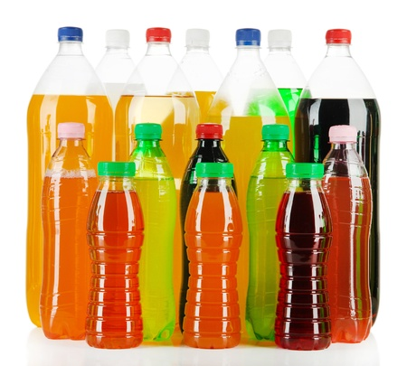 soft drinks: Assortment of bottles with tasty drinks, isolated on white Stock Photo