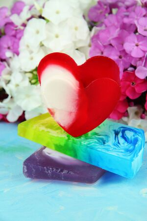 Pieces of handmade soap, on bright background photo