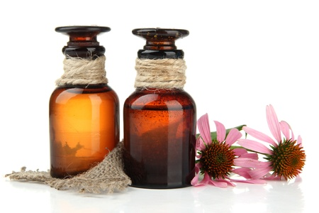 Medicine bottles with purple echinacea, isolated on white photo