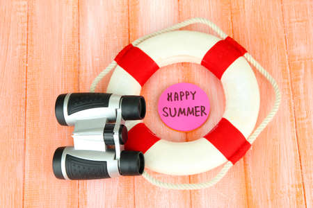 diving save: Lifebuoy on color wooden background