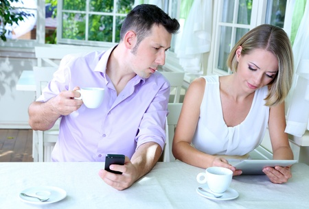 Young couple  taking  with tablet in restaurant photo