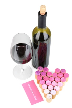 Wine corks laid out in form of heart and bottle of wine isolated on white photo