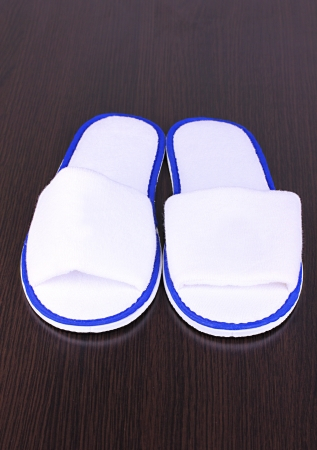 slippers on wooden background photo