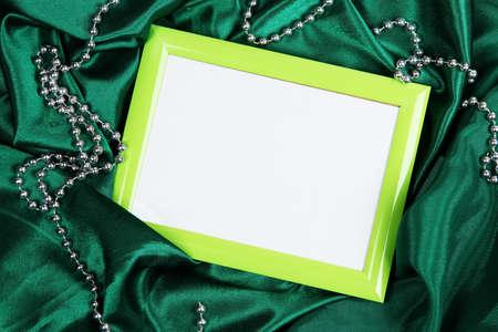 Empty frame on beautiful silk background photo