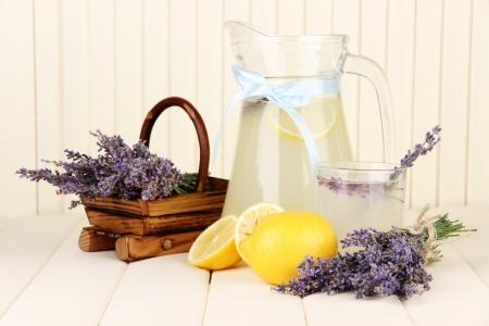 Lavender lemonade, on white wooden background photo
