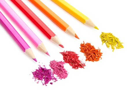 Colour pencils with sharpening shavings isolated on white photo