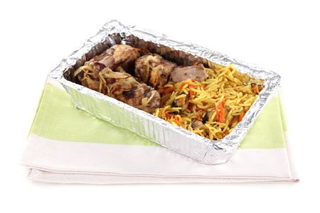 Food in box of foil on napkin  isolated in white photo