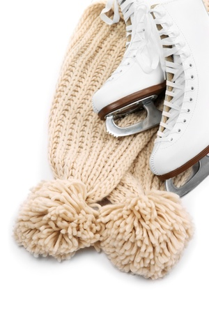 Figure skates with scarf isolated on white Фото со стока