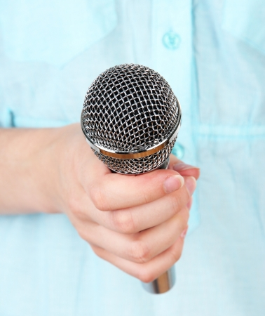 Female with microphone close-up background photo