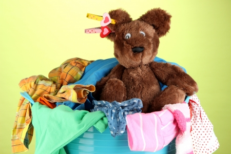 Blue laundry basket on green background Stock Photo - 21342883