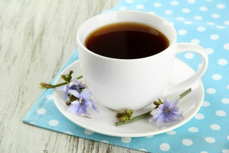 chicory coffee: Cup of tea with chicory, on wooden background Stock Photo
