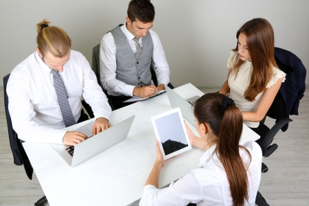 Group of business people having meeting together photo