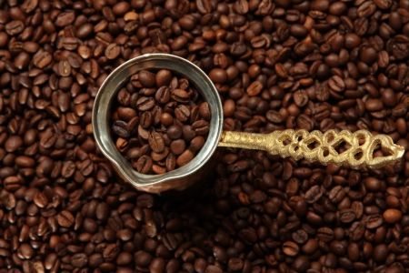 Metal turk on coffee beans background photo