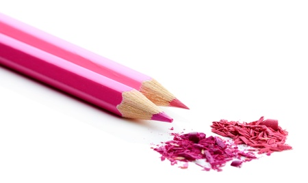 sharpening: Pink pencils with sharpening shavings isolated on white