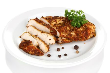 Roasted chicken fillets on white plate, isolated on white Stock Photo - 21444380