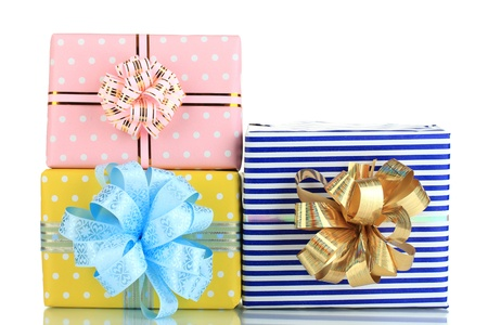 Tapes for wrapping gifts with holiday gifts isolated on white photo