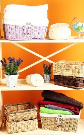 Beautiful white shelves with different home related objects, on color wall background Stock Photo - 21472940