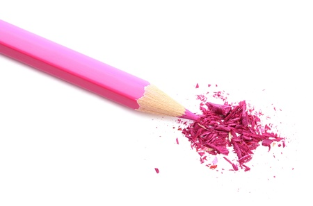 sharpening: Pink pencil with sharpening shavings isolated on white