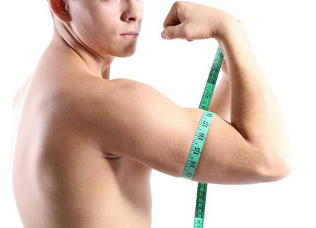 Handsome young muscular sportsman with measuring tape, isolated on white photo