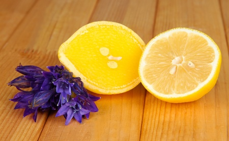 Aroma candle and lemon on wooden background close up photo