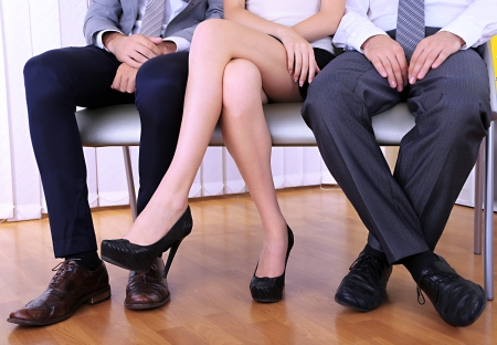 woman legs: People waiting for job interview Stock Photo