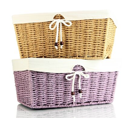 Two empty color wicker baskets, isolated on white Stock Photo - 21552047