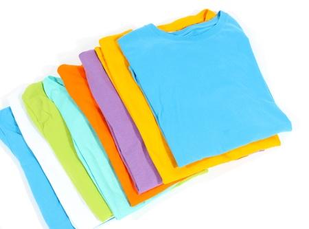 neatly: Neatly folded shirts isolated on white