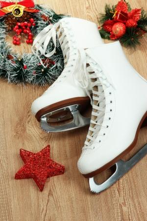 Figure skates on table close-up photo