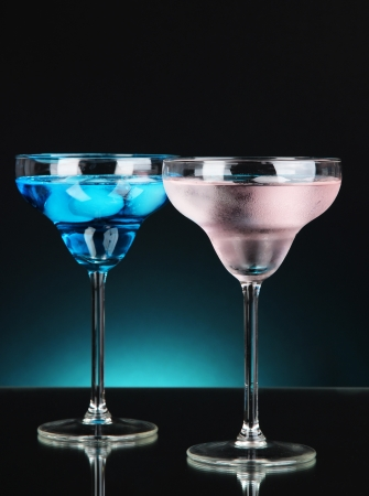 Cocktails on dark color background photo