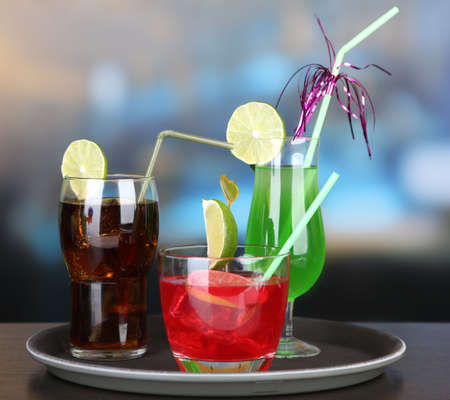Set of different drinks on tray, on bright background Stock Photo - 21552907