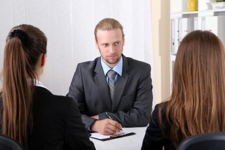 Job applicants having interview photo